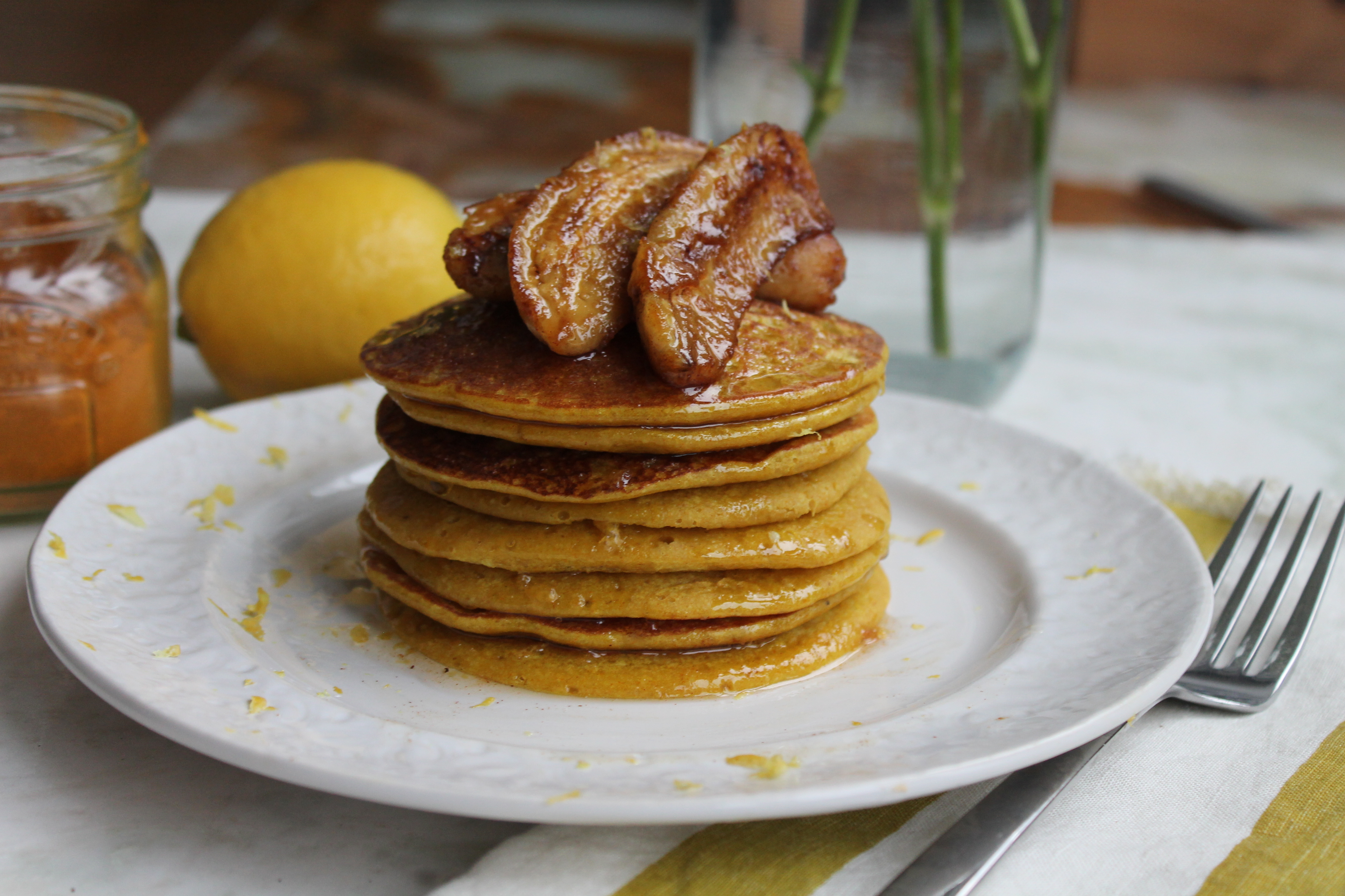 Lemon and turmeric pancakes with caramelised bananas